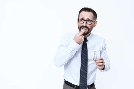 A man stands on a white background.