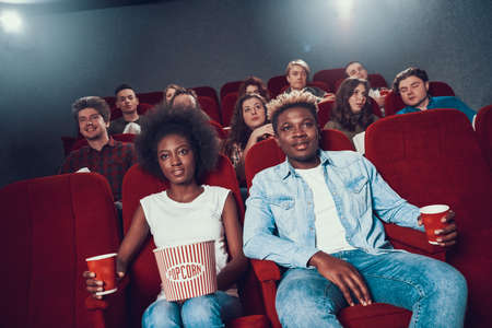African couple with popcorn watching movie. human 写真素材