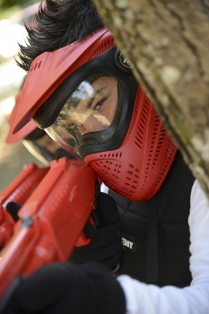 Young children playing paintball in the woods Stock Photo - 23073276