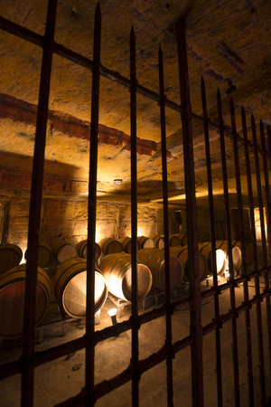 Wine cellar in underground stone quarry photo