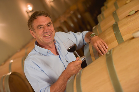 Man tasting wine in cellar, Saint-Emilion, Bordeaux Wineyard, France,