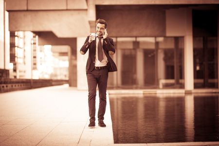phoning: Portrait of a businessman phoning during its break Stock Photo