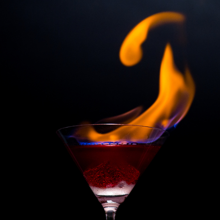 Fire blowing out of martini glassclose-up with black background 6ceee01b9891