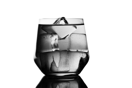 isolated on white: Drinking water-Glass and Ice Cubes-Black and White.