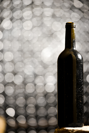 aging: Bottle of red wine in an aging cellar.Close-up