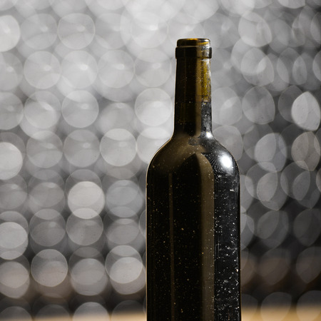 alcohol series: Bottle of red wine in an aging cellar.Close-up