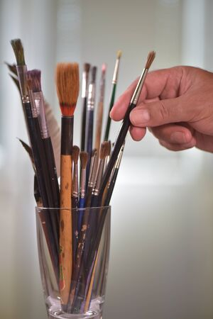 draftsman: Paint brushes in the pot all kinds of brushes