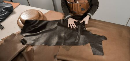 Trunk Maker at work in his luxury leather workshop, France Stock Photo