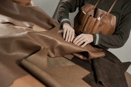 Trunk Maker at work in his luxury leather workshop, France Stock Photo - 55458527