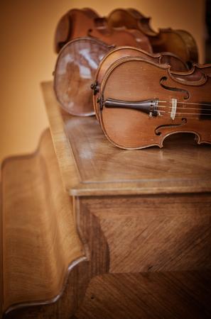 violins: Close up shot of  violins in workshop