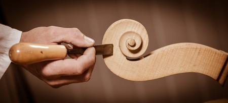 Craftsman working in workshop lutemaker, Violin maker Stock Photo