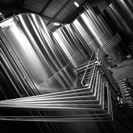 Stainless steel tank at the winery for wine maturation Stock Photo