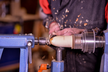 dexterity: Woodturners using a rotating clamp to turn the wood, France Stock Photo