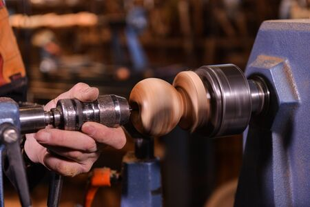 only mid adult men: Woodturners using a rotating clamp to turn the wood, France Stock Photo