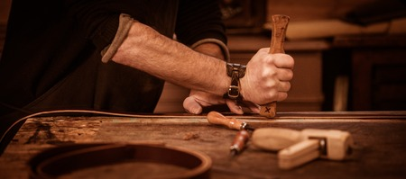 leather goods craftsman at work in his workshop, France Stock Photo