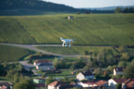 tech no: Flying utility drone over wineyard Champagne France