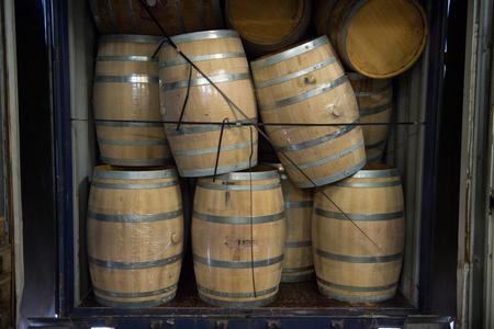 loading dock: Wine barrels stacked in Truck ,Loading dock, Bordeaux Vineyard, France Stock Photo