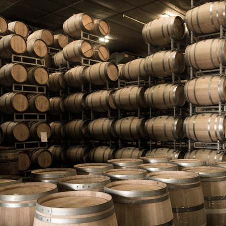 Wine barrels stacked in cellar, Bordeaux Vineyard, France Archivio Fotografico