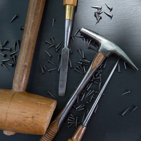 Traditional tools of upholsterer on a table closeup