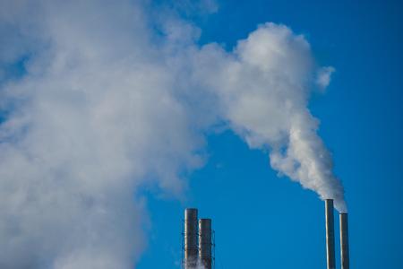 emitting: Smoke Stack Emitting Against Blue Sky Industry