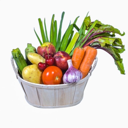 edibles: Fruit and vegetable in a basket, white background