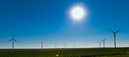 windfarms: Windmills for electric power production on blue sky, France, Europe