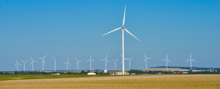 rural development: Windmills for electric power production on blue sky, France, Europe