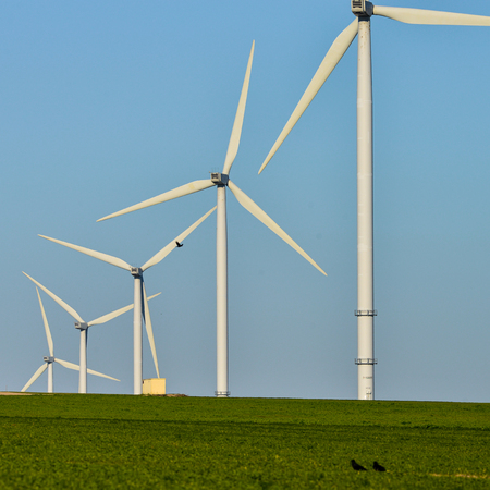 power production: Windmills for electric power production on blue sky, France, Europe