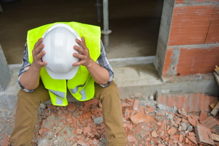 Distraught Construction Worker the head in hands