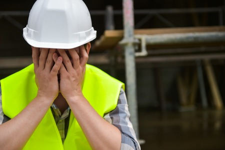 the weariness: Distraught Construction Worker the hands on his face Stock Photo