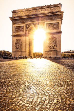 Beautiful sunset over Arc de Triomphe at Place de lEtoile, Paris, France Stock Photo