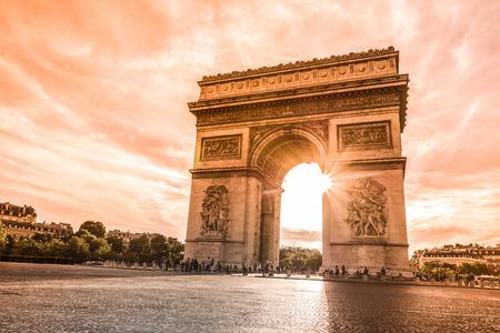 Beautiful sunset over Arc de Triomphe at Place de lEtoile, Paris, France Stock Photo