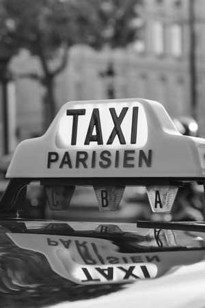 Paris taxi detail and Arc de Triomphe in the background, France
