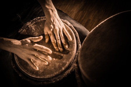 People hands playing music at djembe drums, France