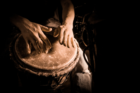 People hands playing music at djembe drums, France Imagens - 65298759