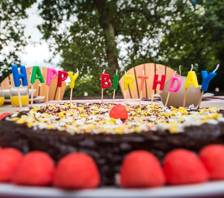 Family celebrating a childs birthday outdoor, France Stock Photo