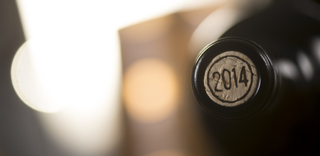 Close-up of closed wine bottles lying on blurry background, winery Stock Photo
