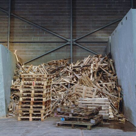 segregation: Huge pile of wood waste for recycling, France Stock Photo