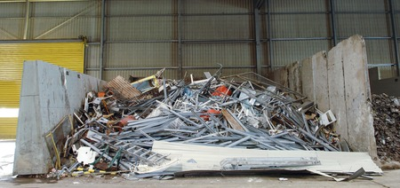 mass storage: metallic waste storage for recycling old heating radiators of cast iron other metals refuse Stock Photo