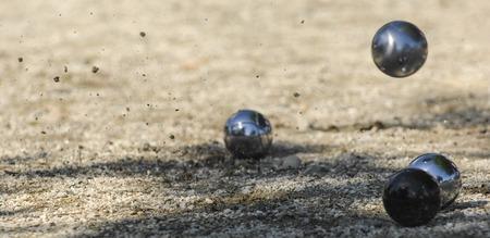 Metallic petanque three balls and a small wood jack, France
