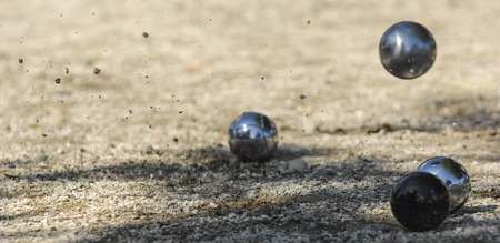 Metallic petanque three balls and a small wood jack, France