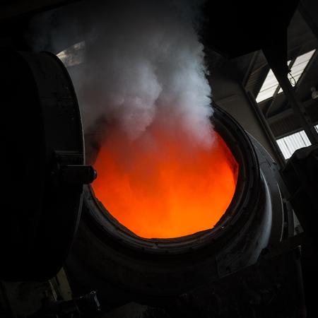 Hot steel pouring in steel plant, iron, aluminium Stock Photo - 71930905