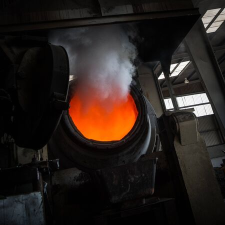 Hot steel pouring in steel plant, iron, aluminium Stock Photo - 71932403