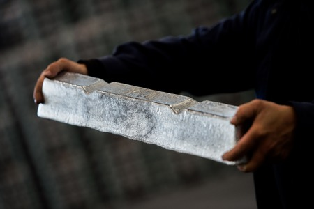 Stack of raw aluminum ingots in aluminum profiles factory, France Stock Photo - 72261313
