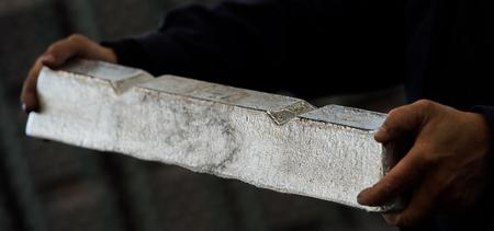 Stack of raw aluminum ingots in aluminum profiles factory, France Stock Photo - 71932498