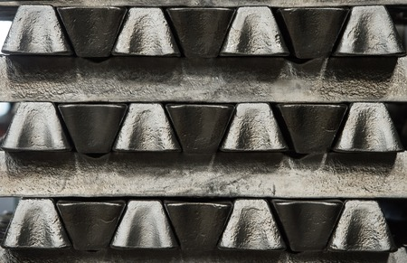 Stack of raw aluminum ingots in aluminum profiles factory, France Stock Photo - 71963213