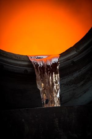 crucible: Hot steel pouring in steel plant, iron, aluminium Stock Photo