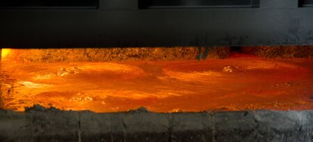 Hot steel pouring in steel plant, iron, aluminium Stock Photo - 71942990