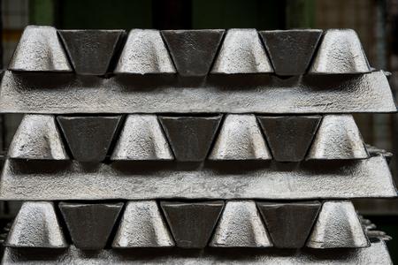 Stack of raw aluminum ingots in aluminum profiles factory, France Stock Photo - 71942307