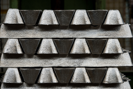 Stack of raw aluminum ingots in aluminum profiles factory, France